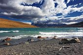 Storm begins. Strong wind drives the clouds and high waves on Lake Laguna Azul. Patagonia, Chile