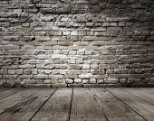 stock photo of row houses  - old room with brick wall - JPG