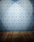 Wooden floor and spotlit wallpaper