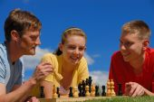 Father Play Chess With Children