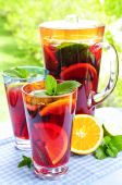 picture of cold drink  - Refreshing fruit punch beverage in pitcher and glasses - JPG