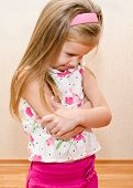 stock photo of disobedient  - Portrait of disobedient crying little girl at home - JPG