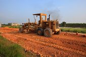 heavy grader machine vehicle working on road construction site
