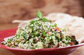 foto of flat-bread  - Gourmet Middle Eastern salad Tabbouleh with pita bread - JPG