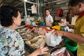 SINGAPORE - SEPTEMBER 19: A lady buys fresh fish from a stall on September 19, 2013 in Toa Payoh Mar