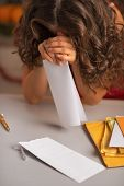 Closeup On Stressed Young Housewife With Letter