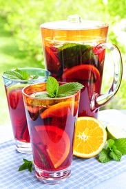 stock photo of cold drink  - Refreshing fruit punch beverage in pitcher and glasses - JPG