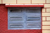 stock photo of postbox  - Old postboxes on red white wall in Brazil - JPG