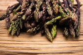 Wild Asparagus Close Up On Old Wooden Background