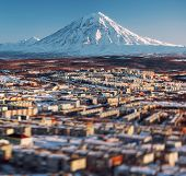 Petropavlovsk-kamchatsky Cityscape And Koryaksky Volcano At Sunrise. Far East, Russia. Image With An