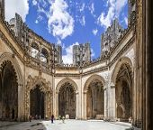 Batalha, Portugal - July 17, 2013: Tourists stroll around the interior of the Unfinished Chapels - Capelas Imperfeitas of the Batalha Monastery. UNESCO World Heritage Site.