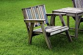 picture of lawn chair  - Wooden chair in the garden with a lawn in the background - JPG