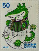 JAPAN - CIRCA 2000: A stamp printed in japan shows Cartoon  crocodile Gena, circa 2000