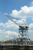 Dockside crane in Red Hook section of Brooklyn with the view of Freedom Tower and downtown Manhattan