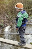 Child On Bridge Over Stream