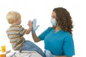 Health Care Professional Gives Toddler A High Five