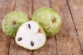 stock photo of custard  - Tropical custard apple fruit on wooden background