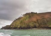 pic of sark  - Coastal scene on Sark Lighthouse Channel Island - JPG