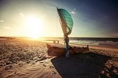 Traditional Malagasy boat on sandy beach. Morondava, Madagascar