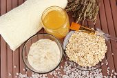 Homemade facial mask with oats and honey,on color wooden background