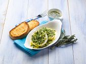 marinated tomino cheese with herbs