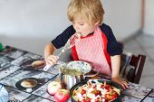 Kid Boy Helping And Baking Apple Pie In Home''s Kitchen