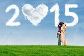 Couple Kissing Under Cloud 2015