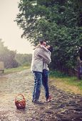 Young couple kissing under rain
