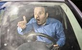 stock photo of yell  - Angry driver yelling on some other driver during driving - JPG