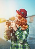 Hipster Woman Making Picture With Retro Camera