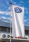 Samara, Russia - September 21, 2014: The Flag Of Volkswagen Over Blue Sky. Volkswagen Is The Biggest