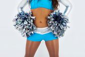 Long-hair cheerleader with pom-poms