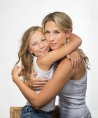 Beautiful blonde mother and daughter embrance each other