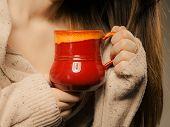 Beverage. Red Cup Mug Of Hot Drink Tea Coffee In Hands