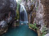 Waterfall On Emerald River