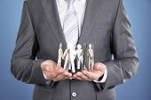 Businessman Holding Paper People