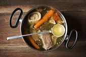 stock photo of stew pot  - Freshly cooked beef soup in large pot - JPG