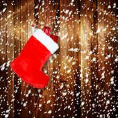 Red Christmas Boot With Gifts On Background Wooden Wall