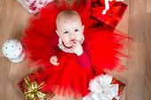 Top View Of Cristmas Baby With Gifts
