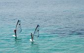 Two windserfers