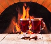 Glasses Of Mulled Wine  Over Fireplace