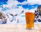 Glass Of Beer Over Winter Landscape