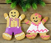 traditional Christmas gingerbread man with festive decorations and Christmas tree