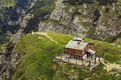 pic of chalet  - Old weathered chalet on top of steep cliff in Bucegi mountains Romania - JPG