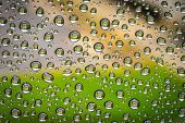 stock photo of rainy day  - Rain drops on a window on a rainy day - JPG