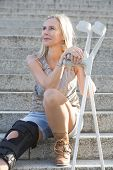 Blonde Woman With Crutches