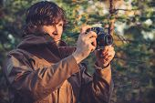 Young Man with retro photo camera outdoor