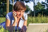 Young Woman With Laptop Outdoors