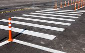 White Traffic Markings With A Pedestrian Crossing On A Gray Asphalt Parking Lot