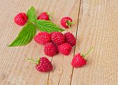 Raspberry With Leaf On Wooden Table